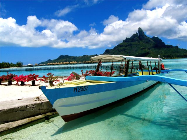 Permanent vacation means life is a beach...like this private one on Bora Bora