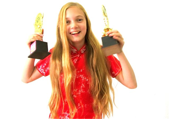 American girl wins two trophies for winning Chinese and English eloction contests