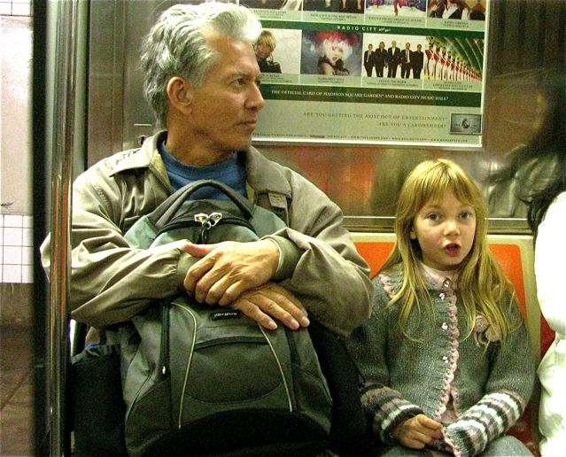 Dad and Daughter taking the train