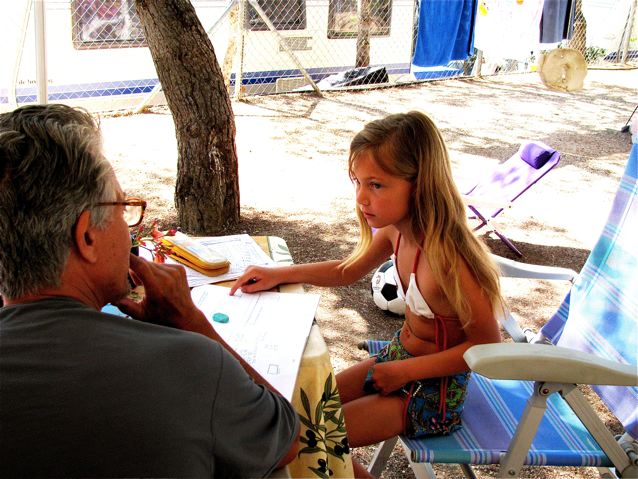 Father helping Daughter with math outside while camping in Barcelona