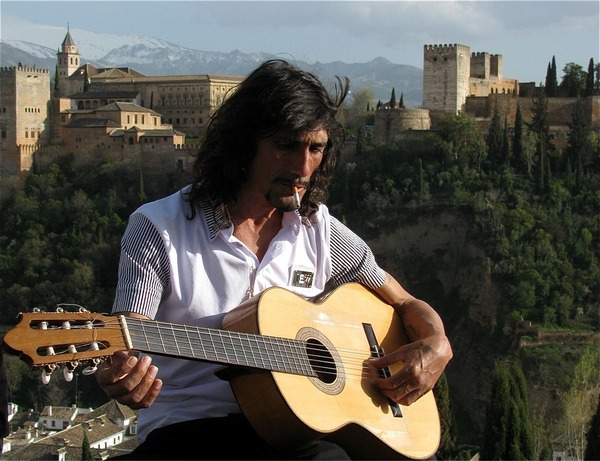 Stunning photo of the Alhambra in Granada with gypsy guitar