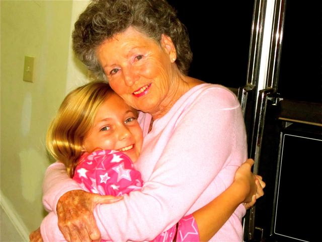travel with kids - means multigenerational travel sometimes with hugs from Grandma