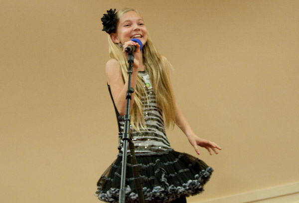 Tween is a Talented Singer/ Songwriter - singing for a large crowd in California