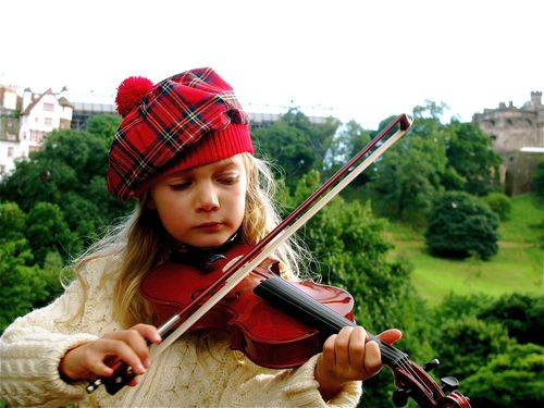 Girl playing violin in Scotland