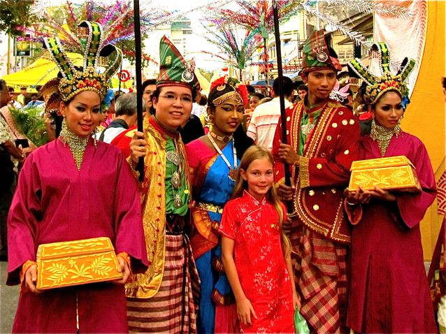 World's Most Well-Traveled Child with costumed friends from many nations in SE Asia