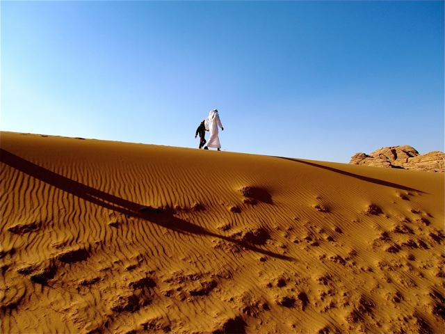 World's Most Well-Traveled Child exploring Wadi Rum on foot with Bedouin friend and guide