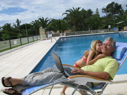 family travel lifestyle -digital nomad - laptop working in Portugal