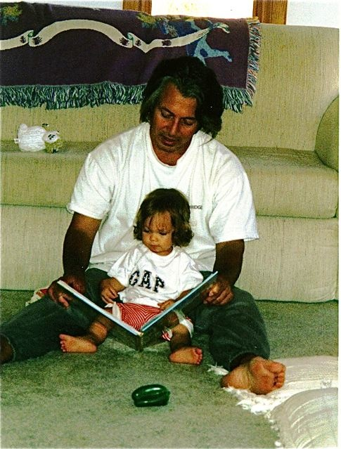 learning a second language as a baby, daddy reading in Spanish to his baby