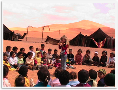Mozart at 6 playing violin for kids as a service project in Morocco's Sahara desert