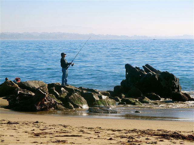 watching people  fishing on the rocks at California  beach