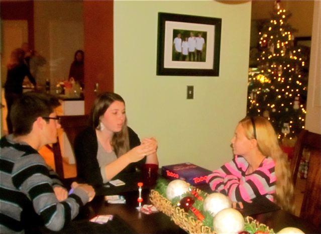 Teens playing games on Christmas Eve