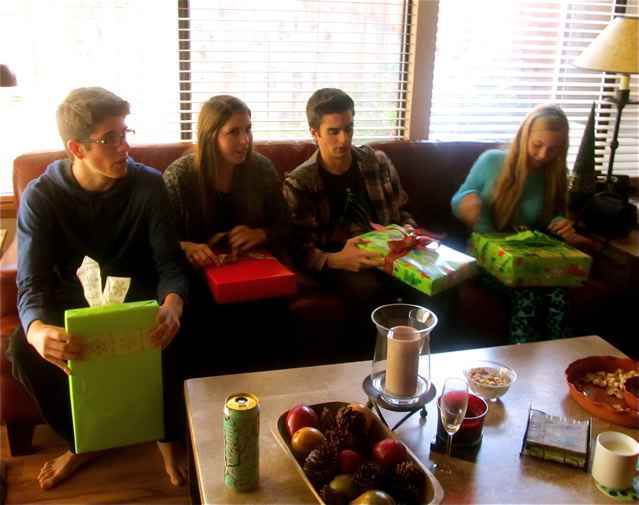 teens opening presents on Christmas morning