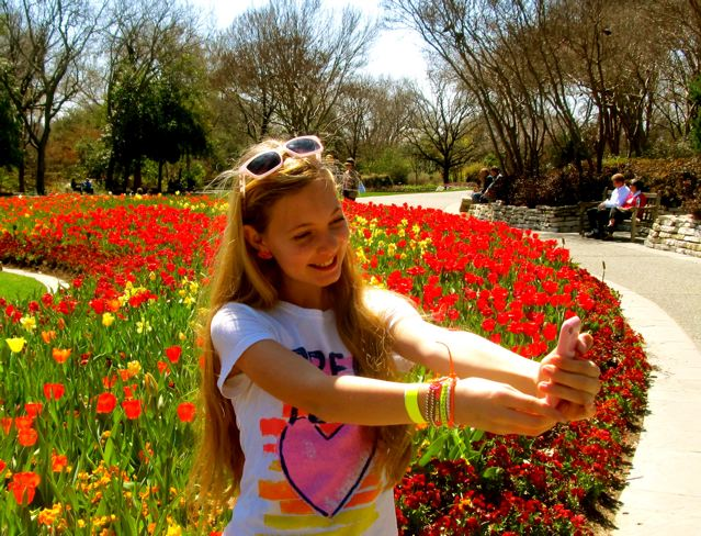 Mozart taking a selfie at the Dallas Arboretum with tulips