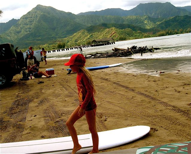 Travel tween Mozart surfing in Hawaii in North Shore Kauai - travel homeschool or world school lifestyle