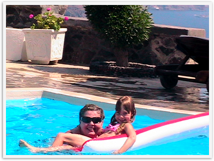 Celebrating Mothers! Mom and daughter swimming on the Caldera in Santorini, Greece