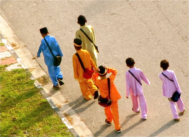 Asia Dream - colorful school boys in Asia dresses for a holiday celebration