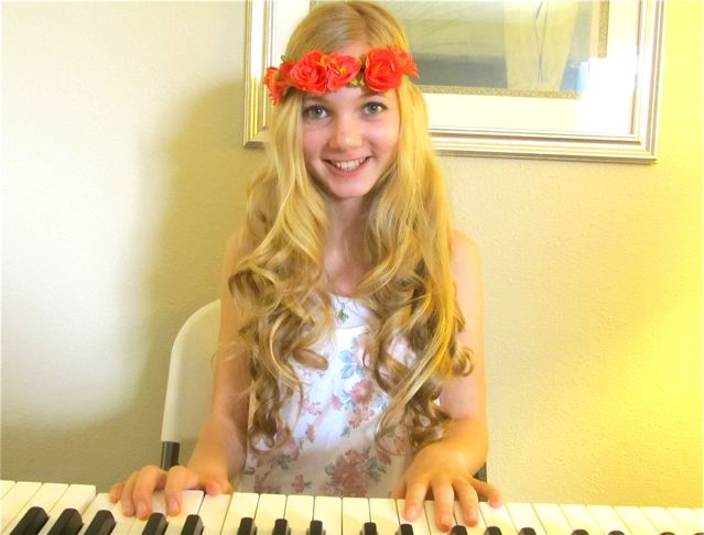 Beautiful travel teen Mozart singing an original song for Earth Day and playing piano