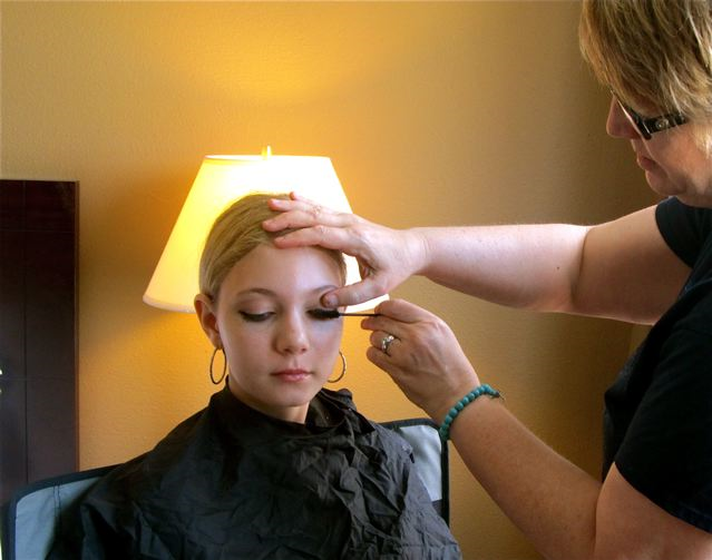 teen getting professional makeup done