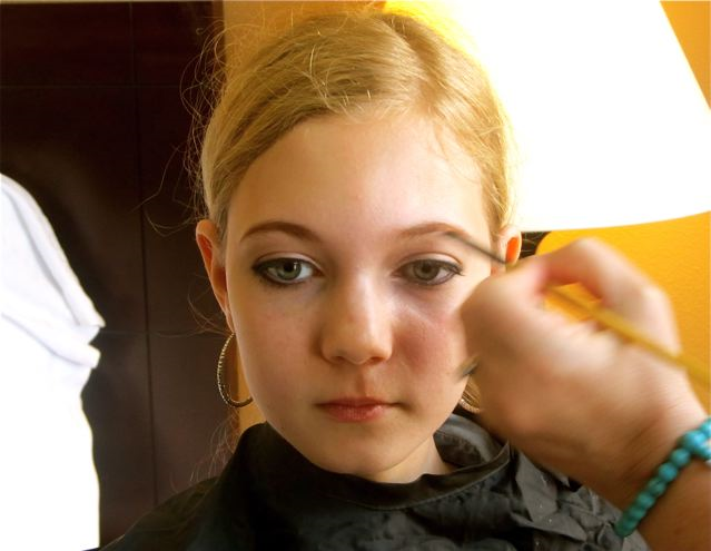 teen getting professional makeup for pop star look