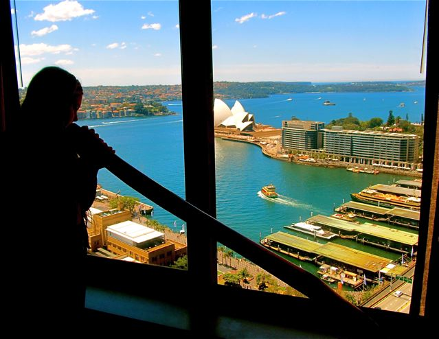 Playing the didgeridoo with gorgeous view of Sydney harbor