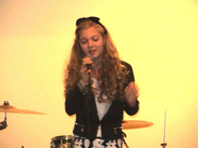 Musical travel teen Mozart singing at a popular venue
