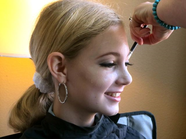 teen Mozart getting professional makeup done for show