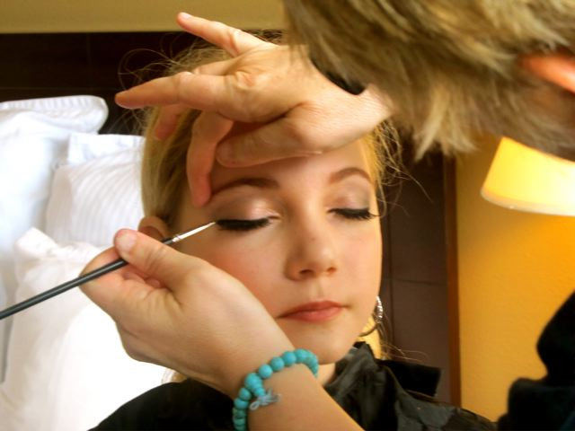 singer Mozart getting professional makeup for Pop star look