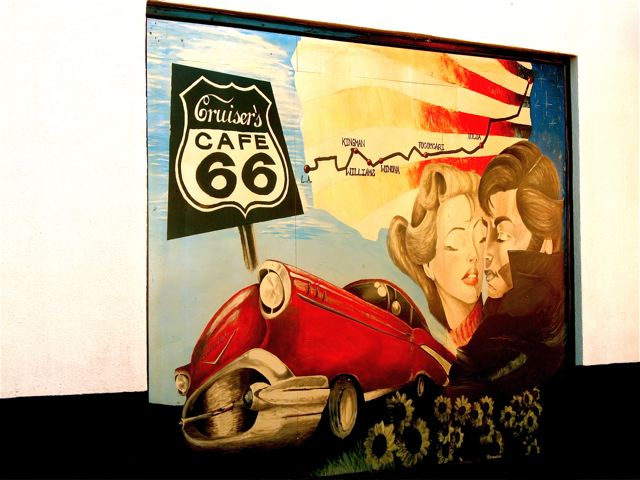 US Route 66 with map, sign and art