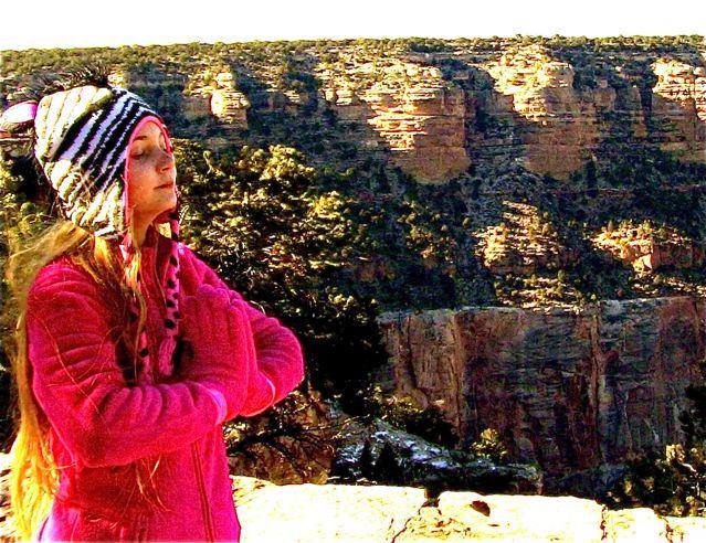 Inspiring travel teen Mozart meditating and saying a prayer at Grand Canyon