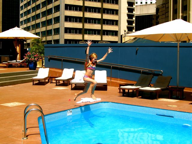 kid jumping for joy at Four Seasons Sydney rooftop pool