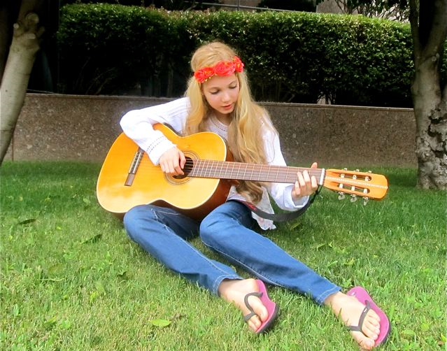 Beautiful singer Mozart playing her guitar and writing a song