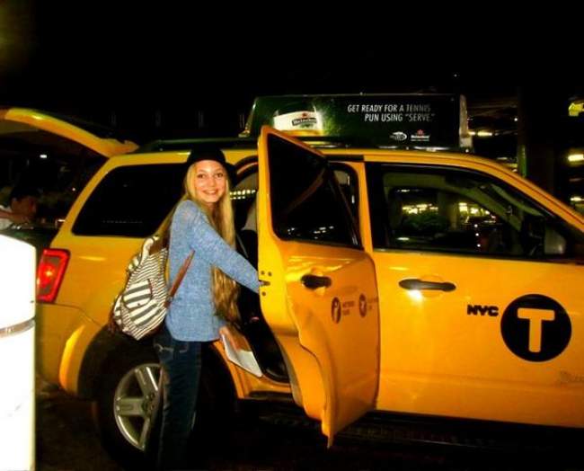 Travel teen Mozart jumping into a cab at Laguardia headed to NYC for fashion week