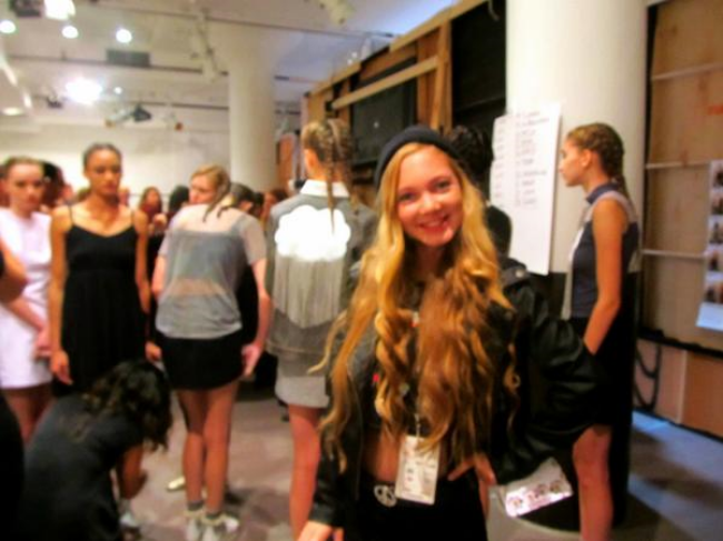 Teen singer and fashion youtuber hanging backstage with the models of New York Fashion Week