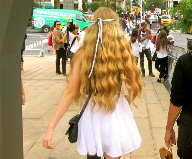Teen singer Mozart being photographed as she leaves New York Fashion Week at Lincoln Center...beautiful, natural, blond  hair