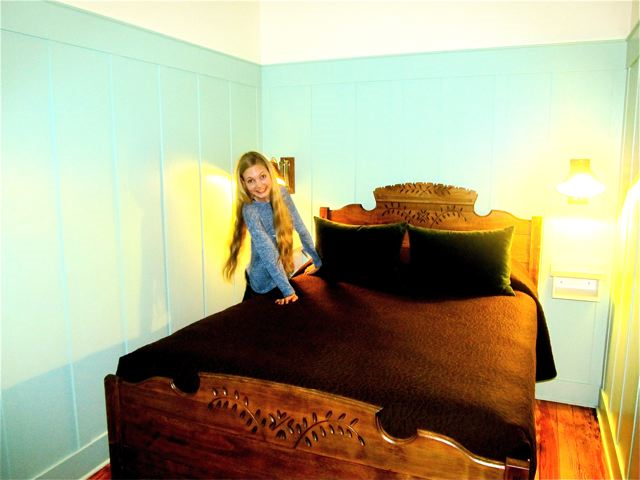 Teen singer Mozart likes this antique bed!