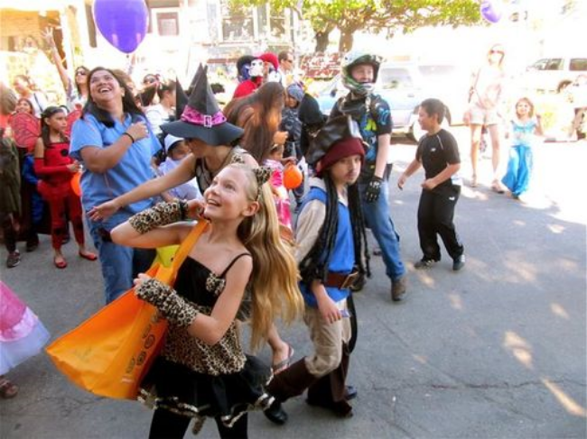 Halloween travel around the world-catching candy at the Halloween parade