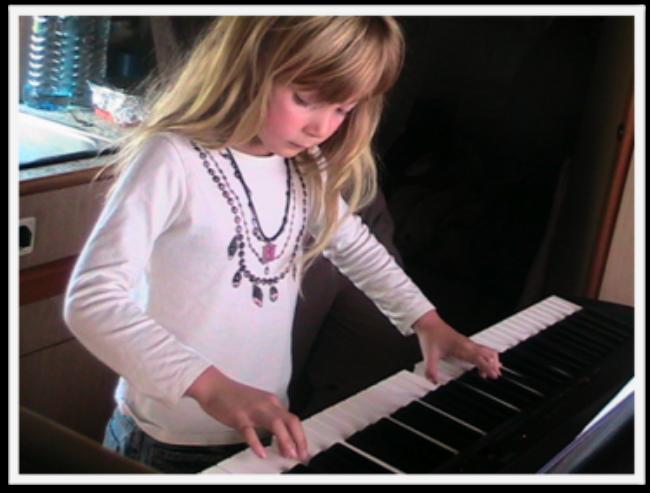 Travel kid Mozart playing piano in her camper van