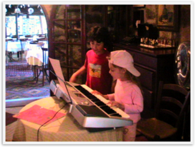 blonde Mozart playing piano practice at hotel in Turkey