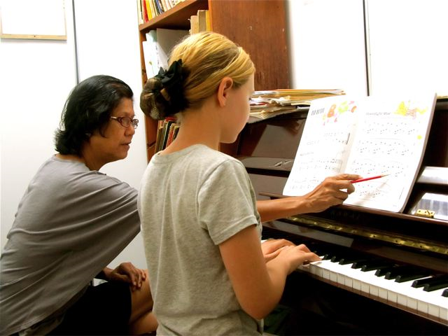 blonde singer Mozart taking piano lessons in Malaysia & around the world