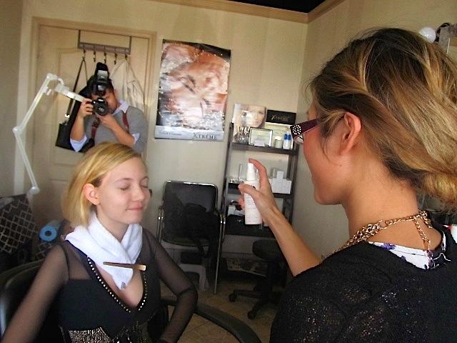 teen singer Mozart getting make up done