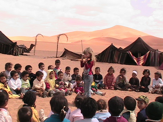 The Top 10 Reasons to Travel with Kids - Mozart giving a concert in the Sahara in Morocco