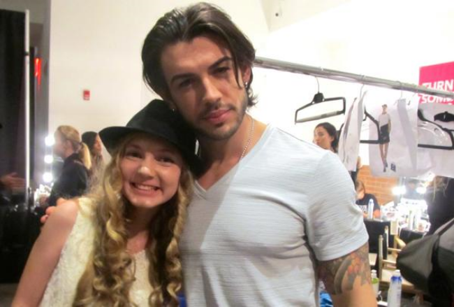 singer and youtuber Mozart with male model backstage at NYFW