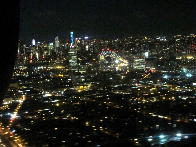 NYC from the air lit up at night
