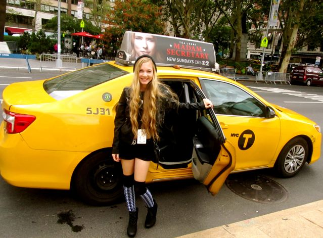 travel teen and singer Mozart coming out of a taxi in NYC during fashion week