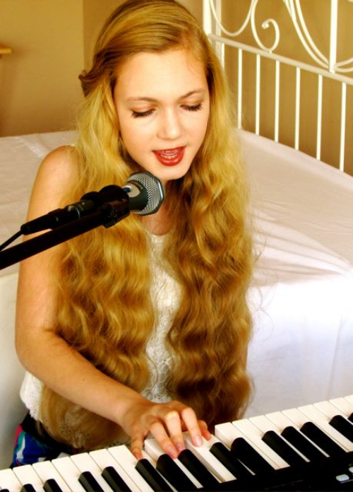 Beautiuful trilingual travel teen and singer Mozart  singing and playing piano