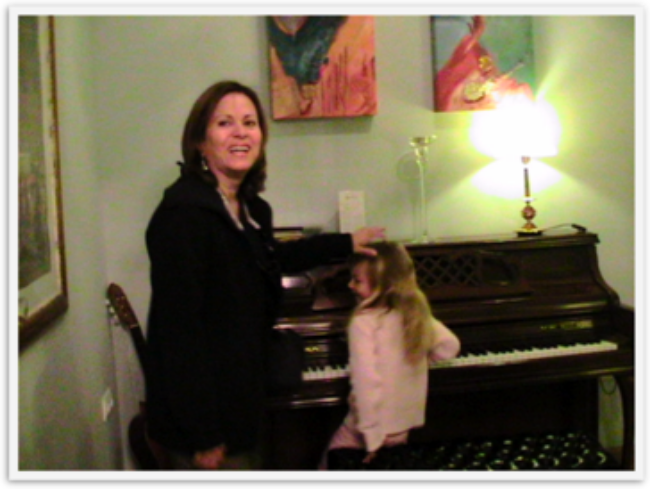 Pretty Mozart playing at Armadeus hotel in Seville on their piano for her aunt