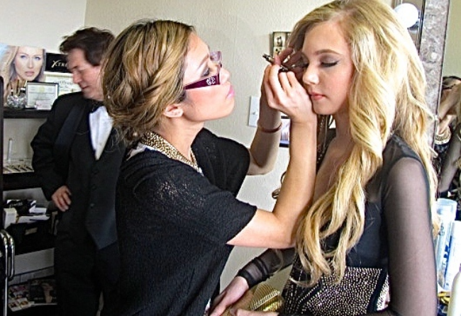 Teen singer getting hair and makeup done for a big red carpet performance