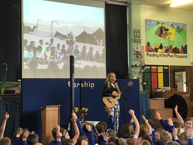 Mozart Dee aka MuzicbyMozart performing in England for students