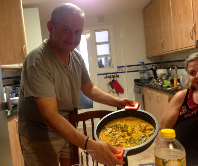 Dinner with friends making paella in Spain