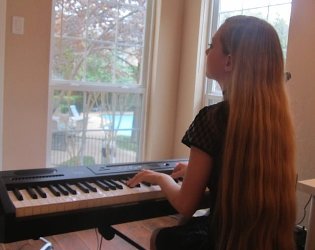 travel teen & singer Mozart playing piano in her bedroom & writing songs